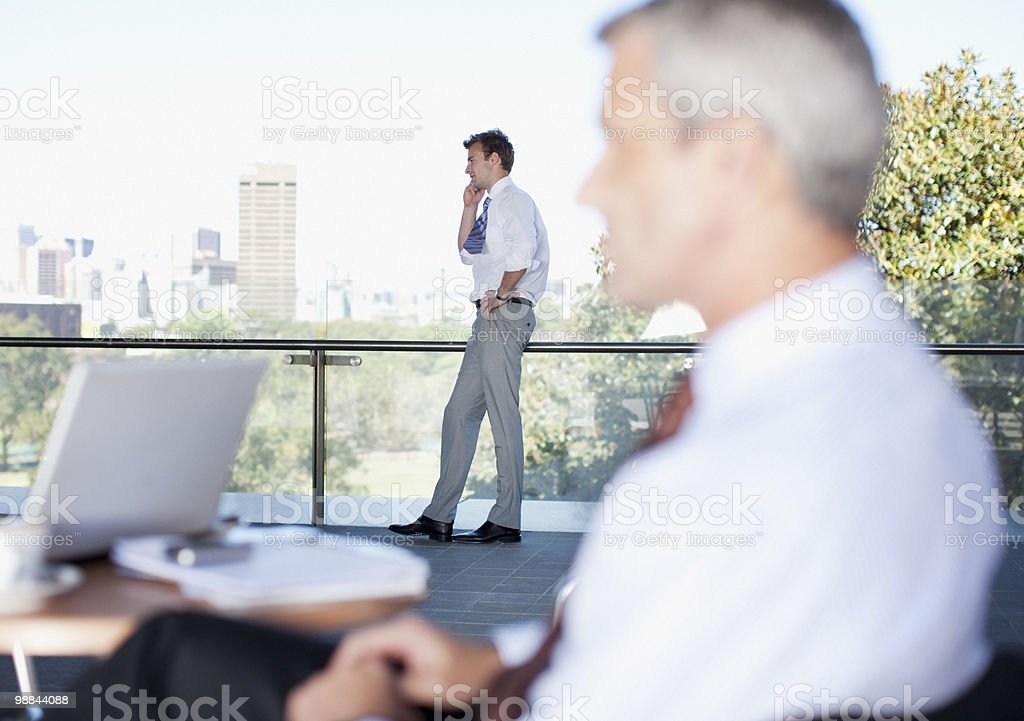 Businessmen in cafe royalty-free stock photo