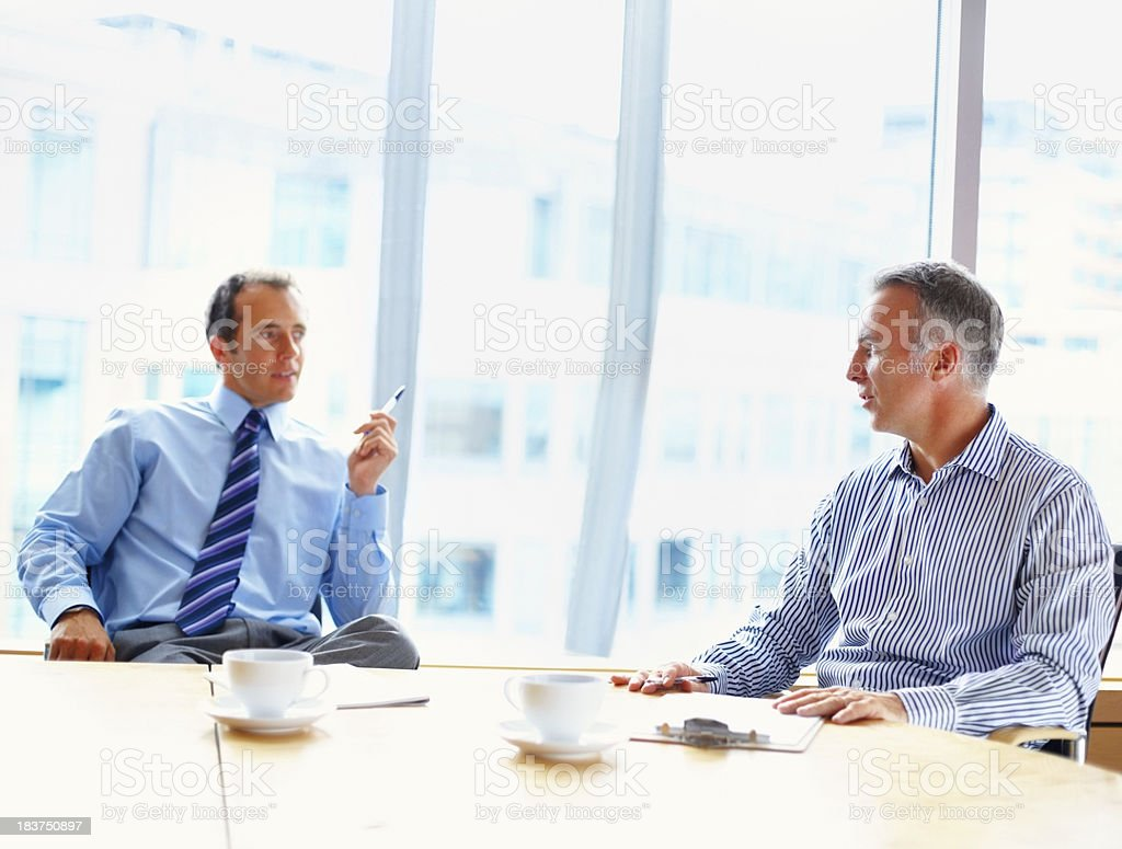 Businessmen in casual meeting over coffee royalty-free stock photo