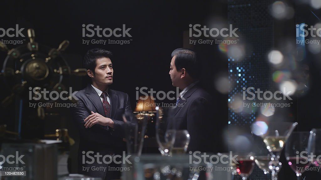 businessmen in conversation stock photo