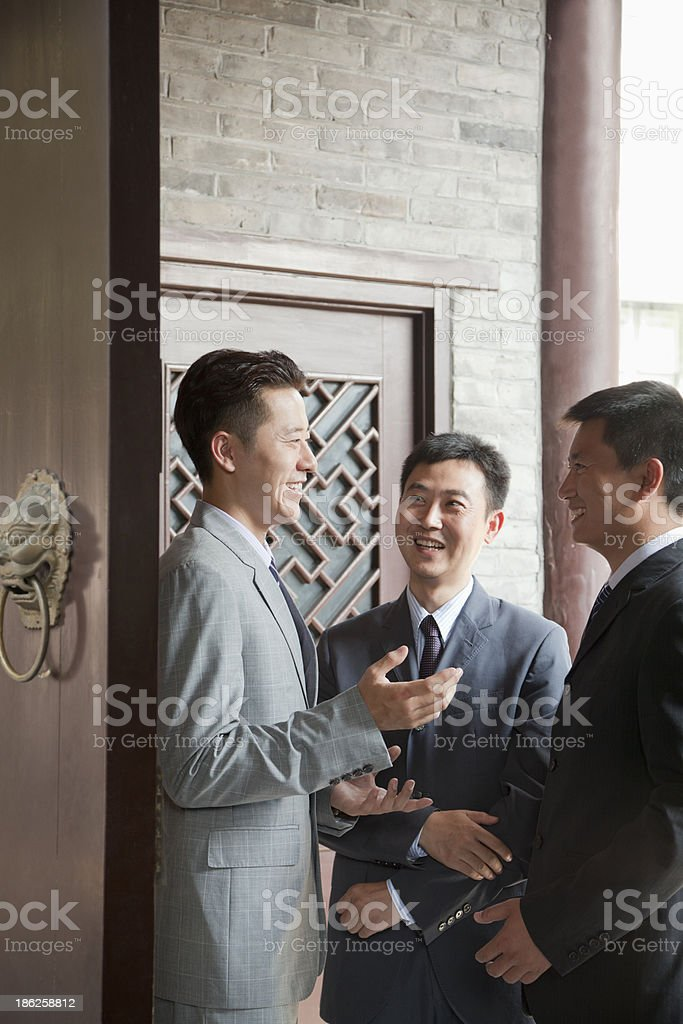 Businessmen in Doorway stock photo