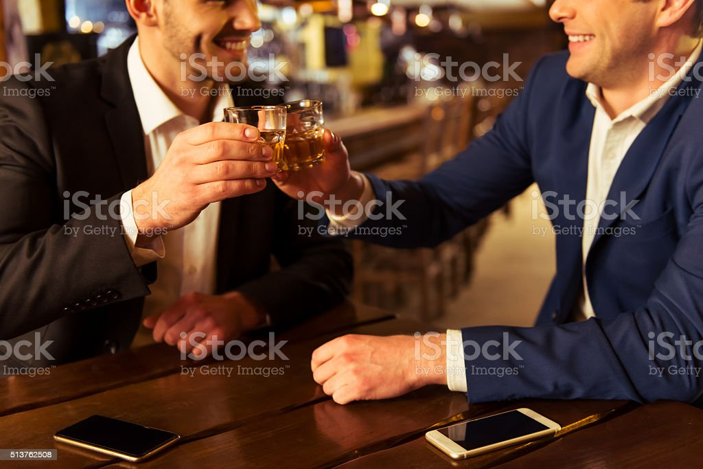 Businessmen in pub stock photo