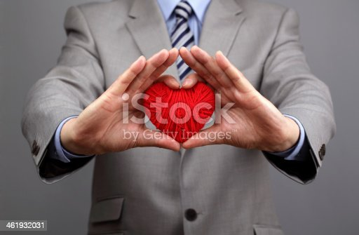 istock Businessmen is holding out a red heart 461932031