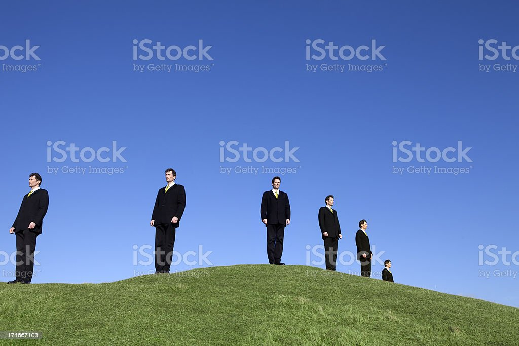 Businessmen Keeping Watch on Hilltop stock photo