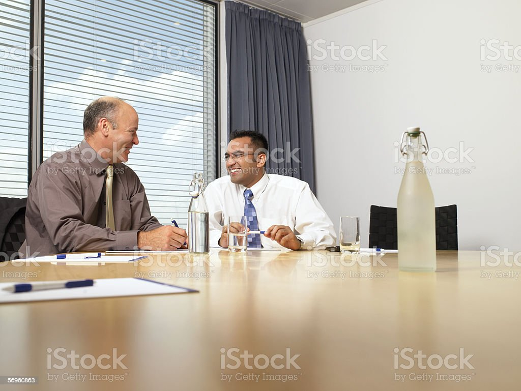 Businessmen laughing royalty-free stock photo