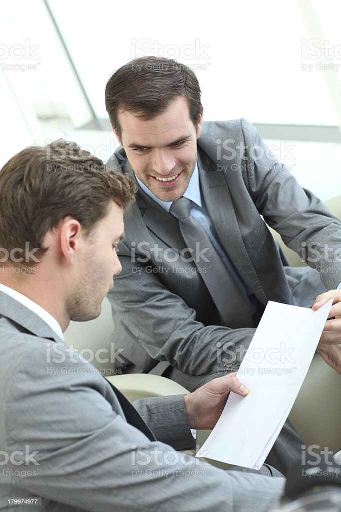 Businessmen looking at informations on contract royalty-free stock photo