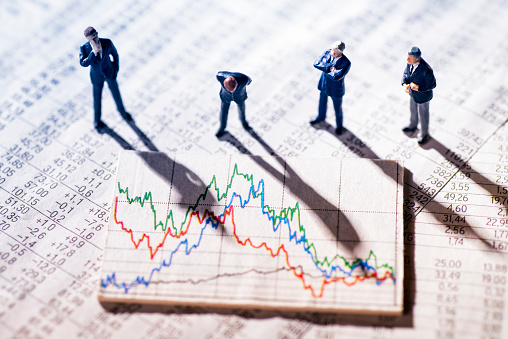 Businessmen Looking At Market Charts Stock Photo - Download Image Now