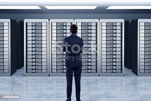 802303672 istock photo Businessmen looking at server 538899668