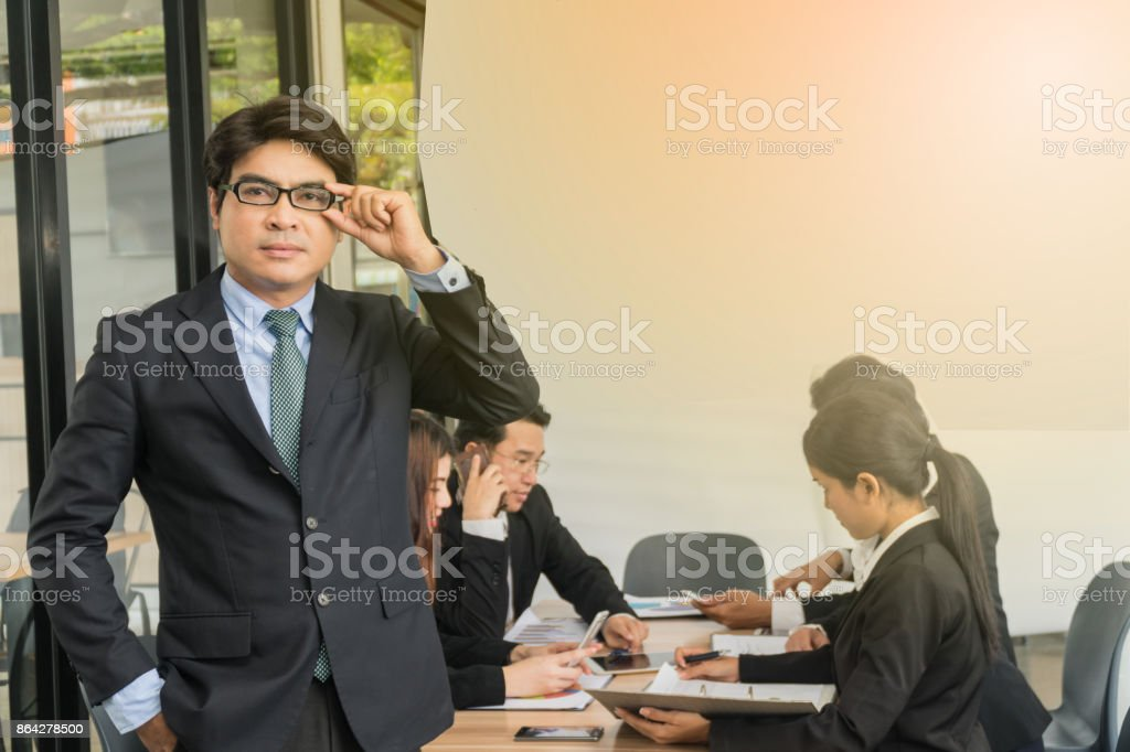 Businessmen meet with middle-aged businessmen standing in front of the table. royalty-free stock photo