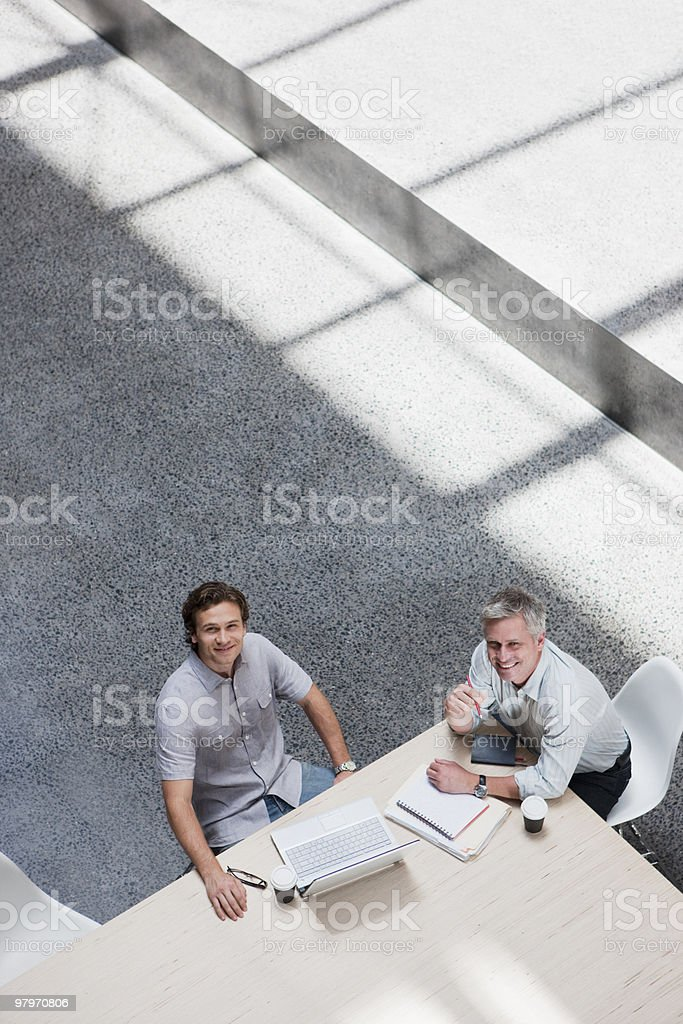 Businessmen meeting at conference table royalty-free stock photo