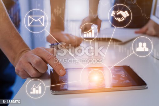 istock Businessmen meeting in modern office with tablet, data, virtual interface 641839870