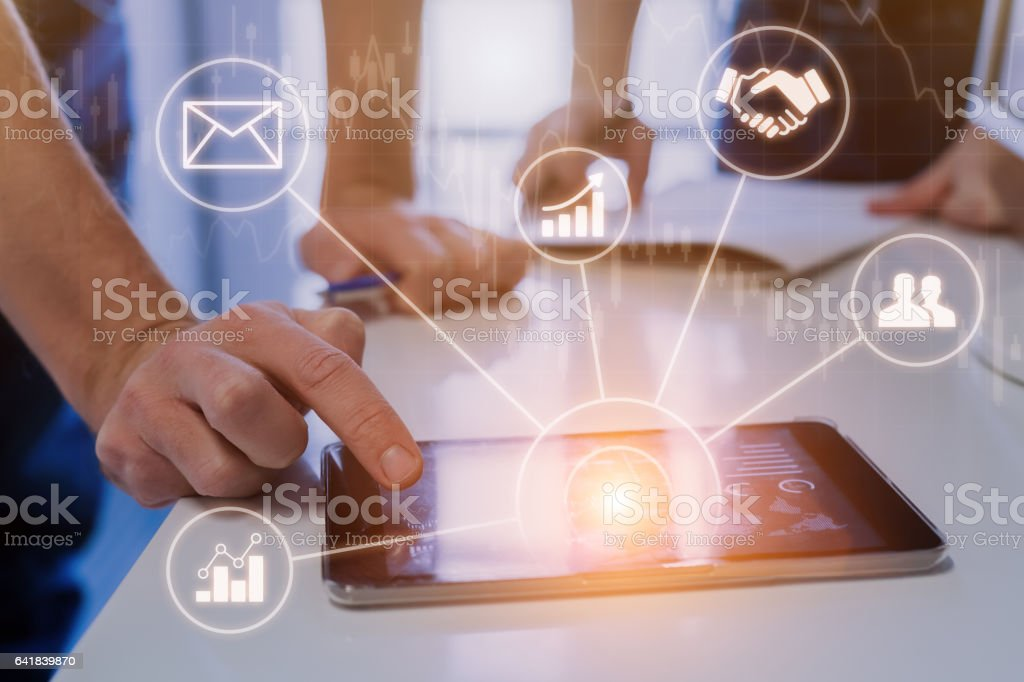 Businessmen meeting in modern office with tablet, data, virtual interface stock photo