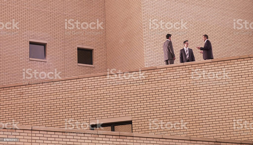 Businessmen meeting on brick building royalty-free stock photo