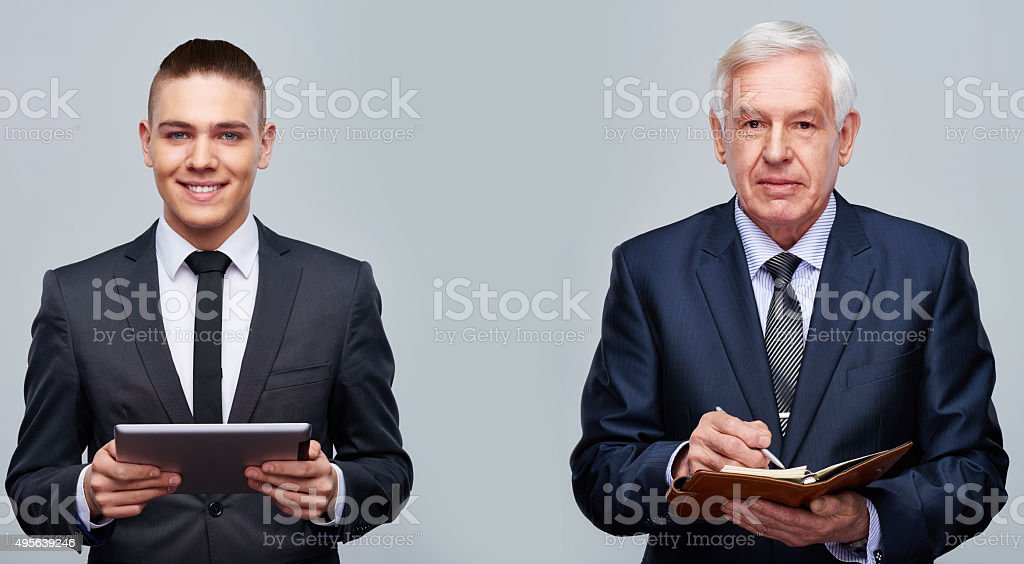 Businessmen of different ages stock photo