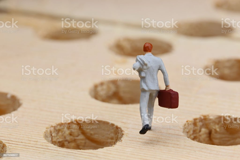 Businessmen of the pitfalls and miniature stock photo