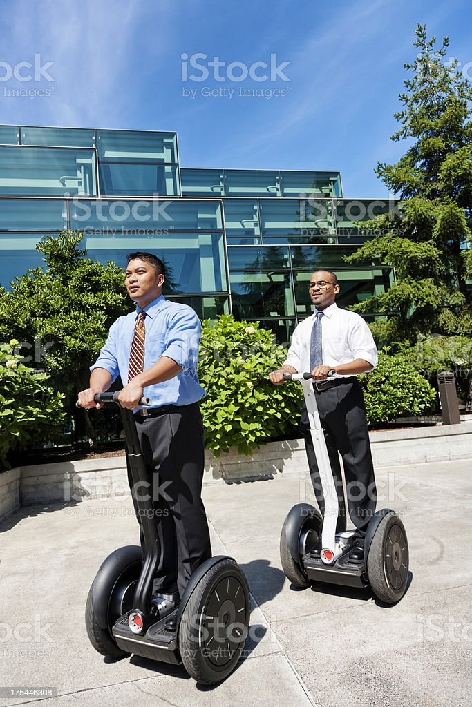Businessmen on Segway Personal Transport stock photo