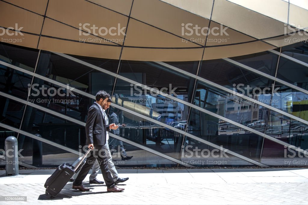 Businessmen on the move in Dubai downtown stock photo