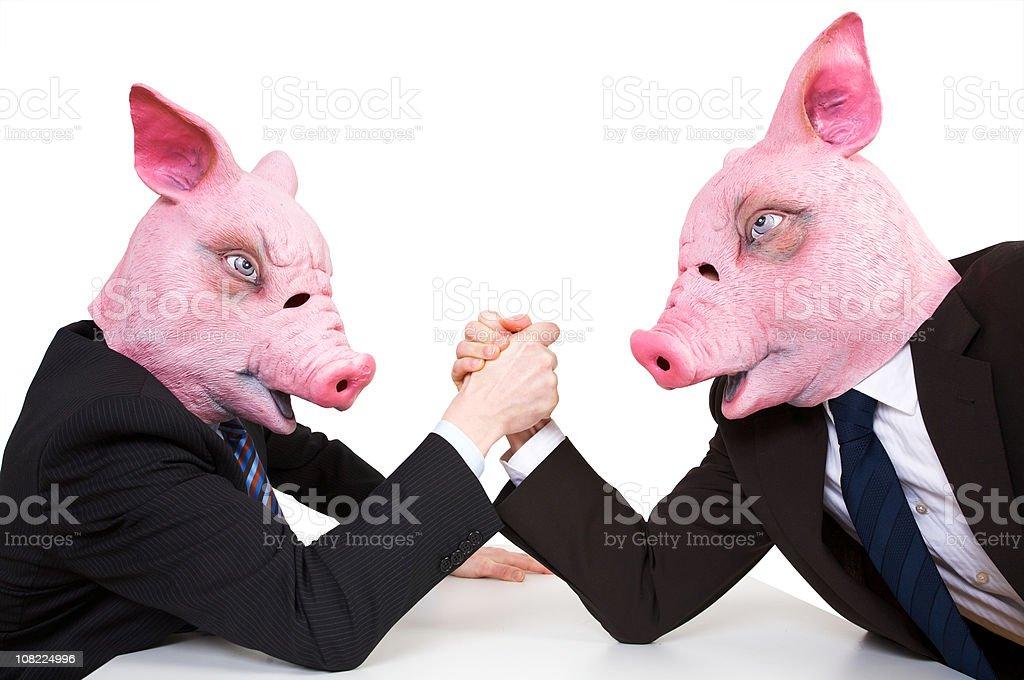 Hommes d'affaires les porcs Bras de fer - Photo