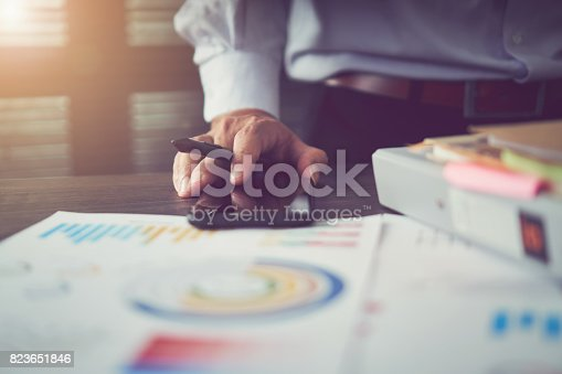 istock Businessmen point their finger at financial charts to demonstrate the company's past performance. Business Concepts by Functionality. vintage effect. 823651846
