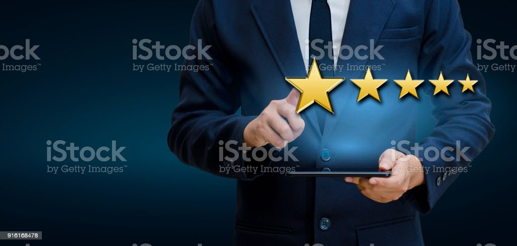 Businessmen pointing five star stars to boost corporate ratings Phone Holder stock photo