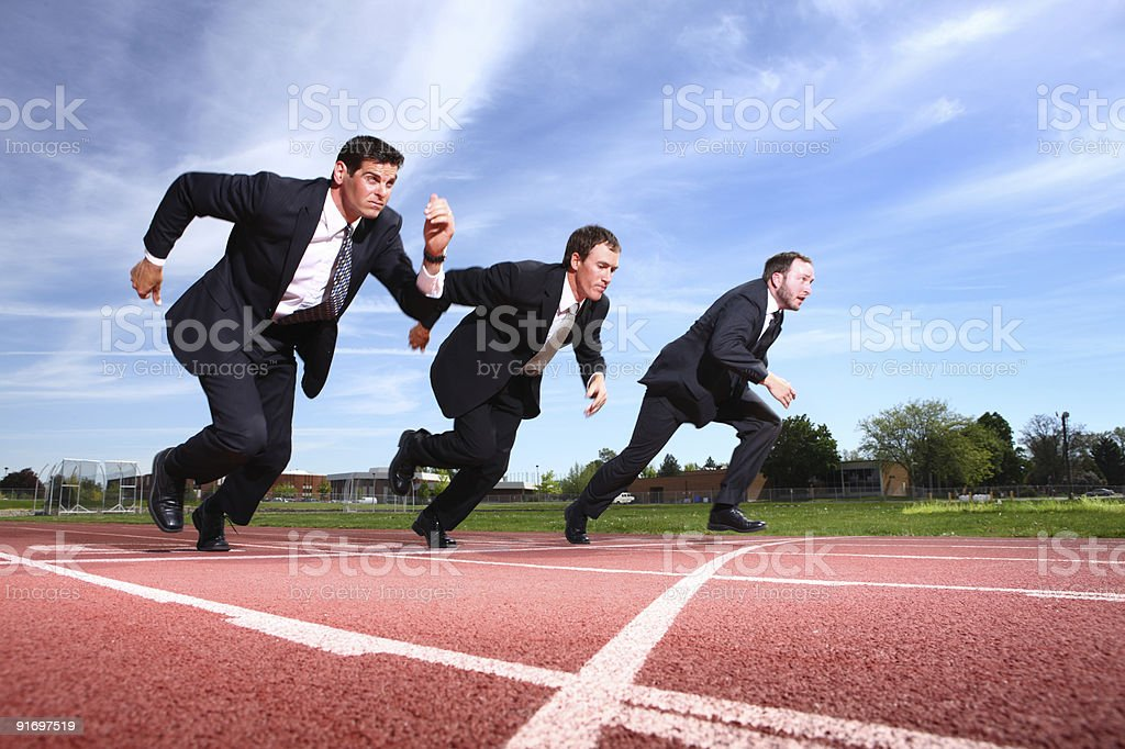 Businessmen racing on track stock photo