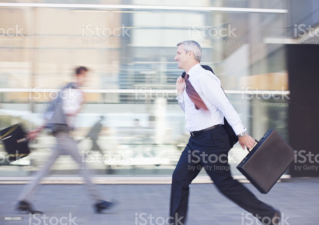 Businessmen rushing outdoors 免版稅 stock photo