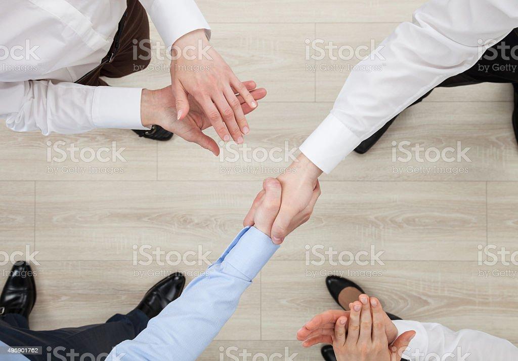 Businessmen shake hands stock photo
