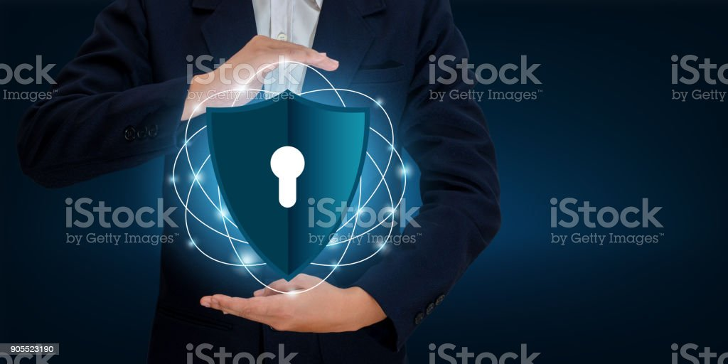 Businessmen shake hands to protect information in cyberspace. Businessman holding shield protect icon protection network security computer and safe your data concept, Space input data stock photo