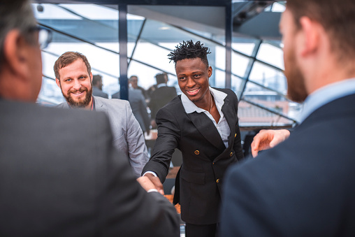 532257236 istock photo Businessmen shaking hands after meeting 935777100