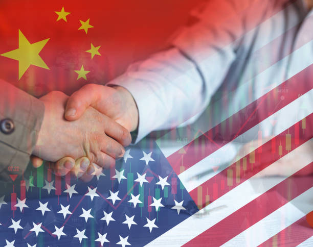 Businessmen shaking hands as a sign of China's cooperation with America. Financial and business cooperation concept. stock photo