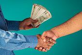 istock Businessmen Shaking Hands & Confirming Deal 1172759832