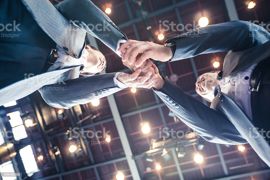 Businessmen shaking hands in agreement over a profitable venture. stock photo
