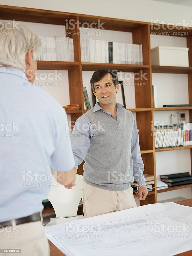 Businessmen shaking hands over the finalization of a plan royalty-free stock photo