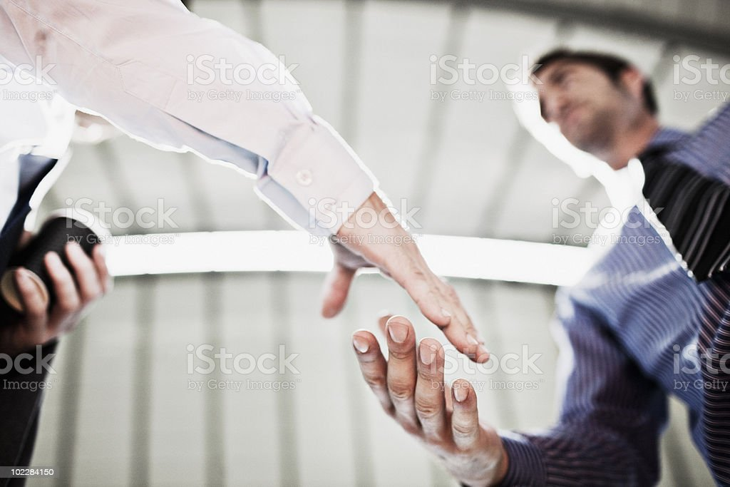Businessmen shaking hands stock photo