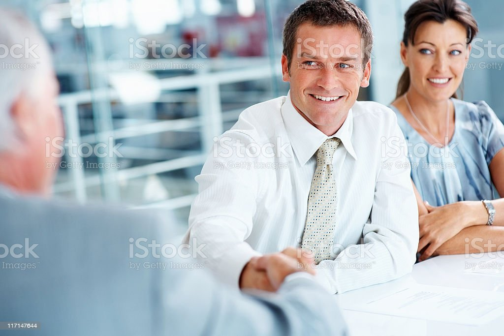 Businessmen shaking hands royalty-free stock photo