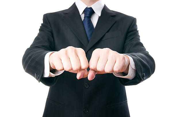 businessmen shows fists - knuckle stock photos and pictures