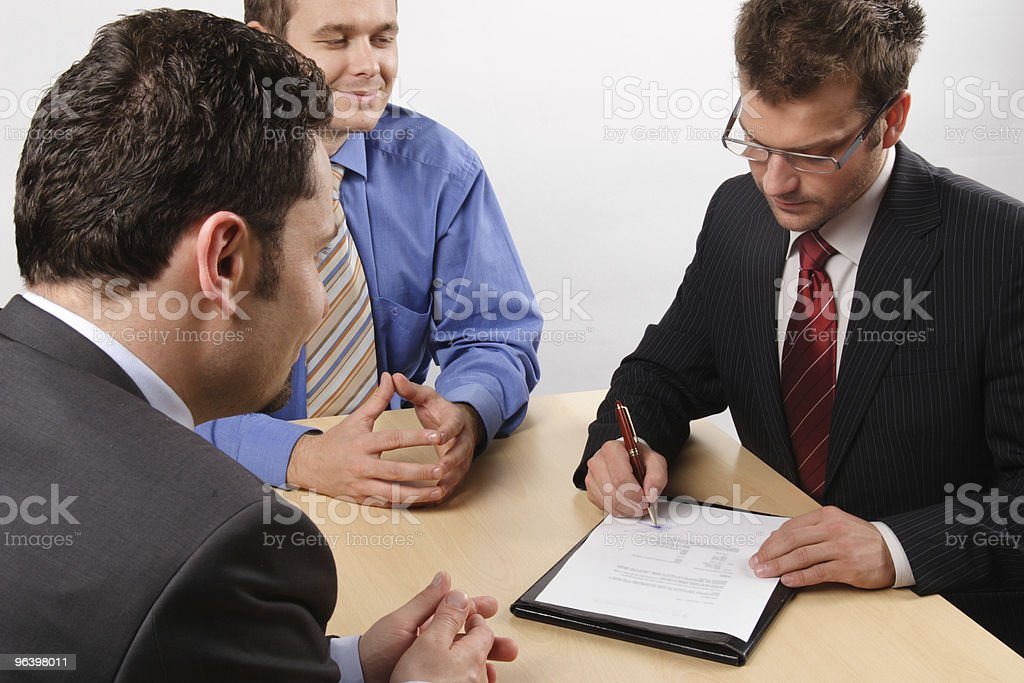 businessmen signing a contract. - Royalty-free Adult Stock Photo