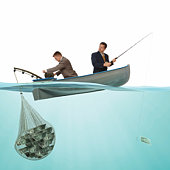 2 business men on a small fishing boat fishing for money.