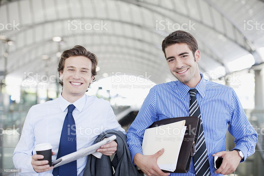 Businessmen smiling together royalty-free stock photo