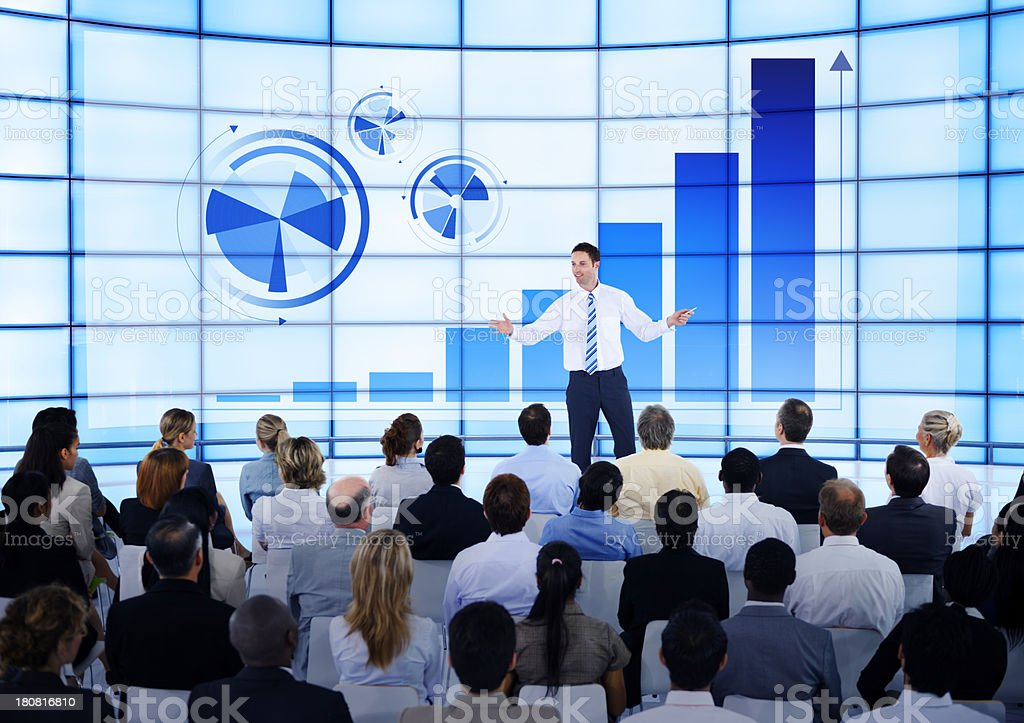Businessmen speaking at a meeting using column models stock photo