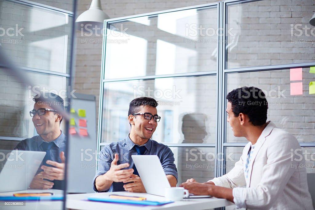 Businessmen speaking stock photo