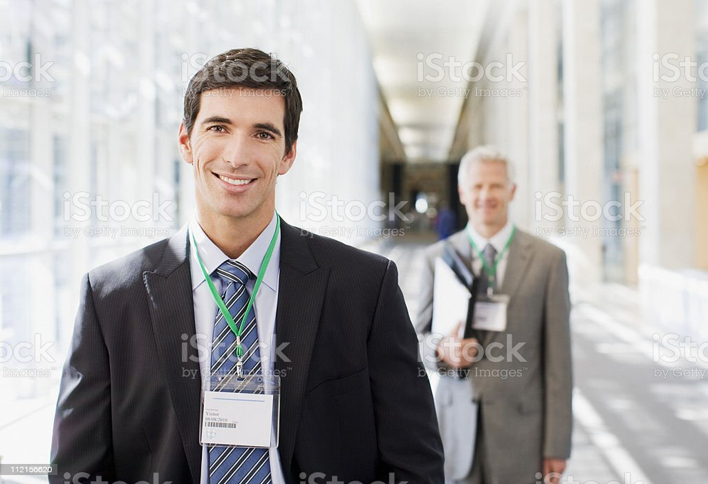 Businessmen standing in office stock photo