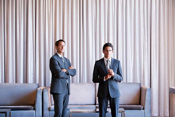 Businessmen standing together on hotel lobby picture id109350646?b=1&k=6&m=109350646&s=612x612&w=0&h=bozweuyuohfamwd1vesftjky9l07aje6zfx19goebz0=