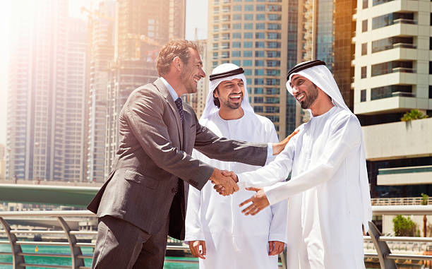 Businessmen struck a deal in Dubai. Businessmen struck a deal in Dubai. Shot from Istockalypse Dubai 2015.  arabia stock pictures, royalty-free photos & images