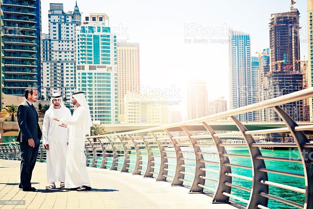 Businessmen struck a deal in Dubai stock photo