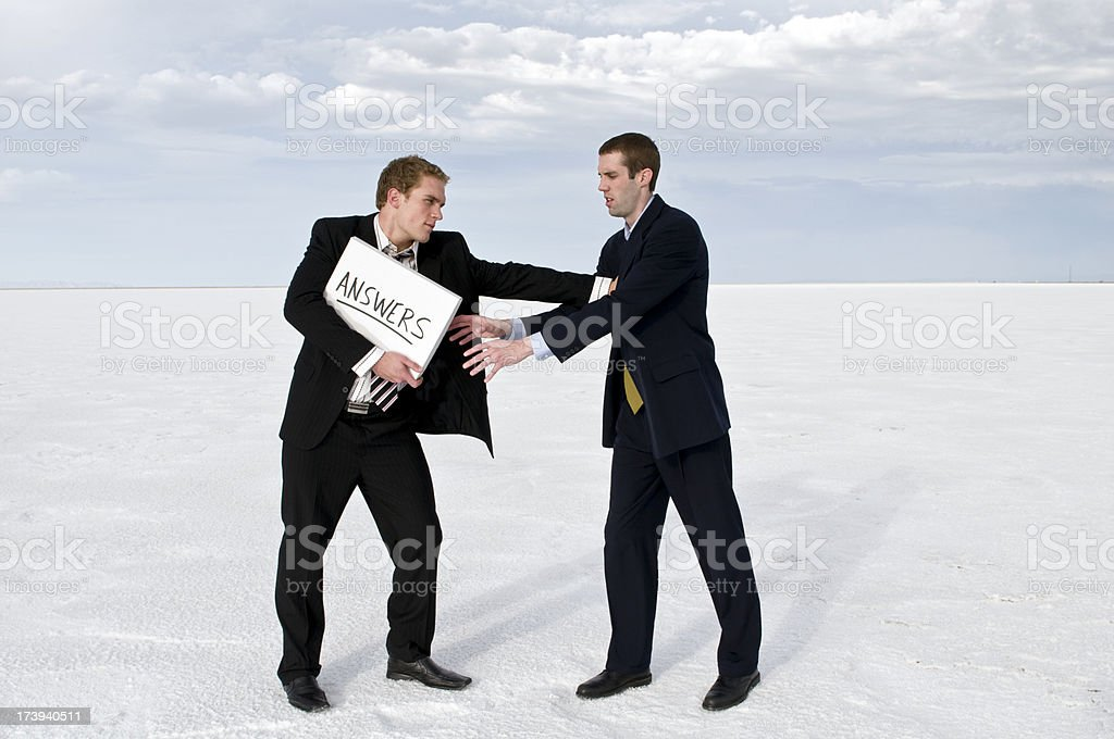 Businessmen struggling with answers stock photo