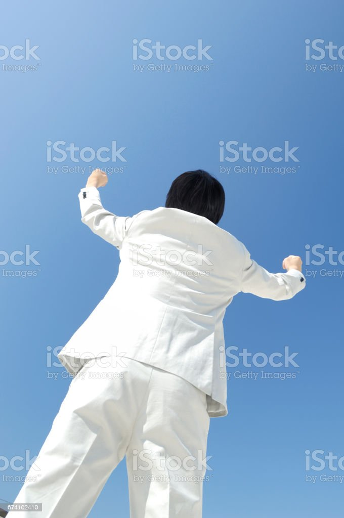 Businessmen take a fist into the air royalty-free stock photo