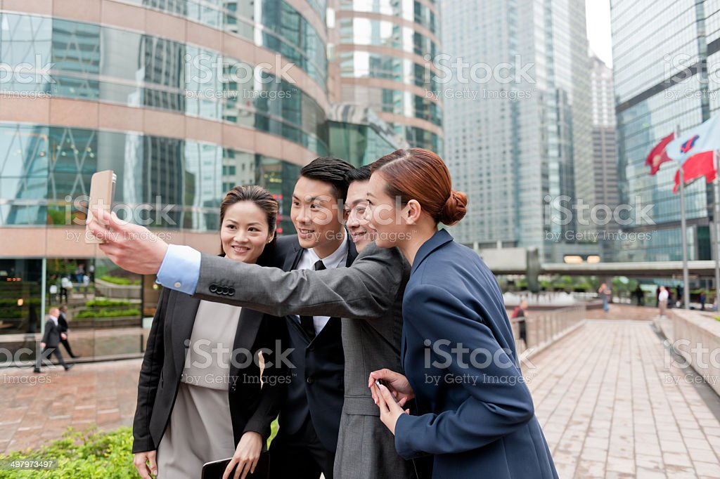 Businessmen taking a Selfie in Hong Kong, China. stock photo