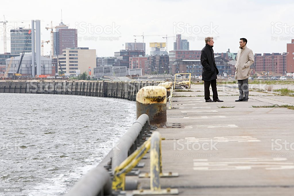 Businessmen talking by a  harbour royalty-free stock photo