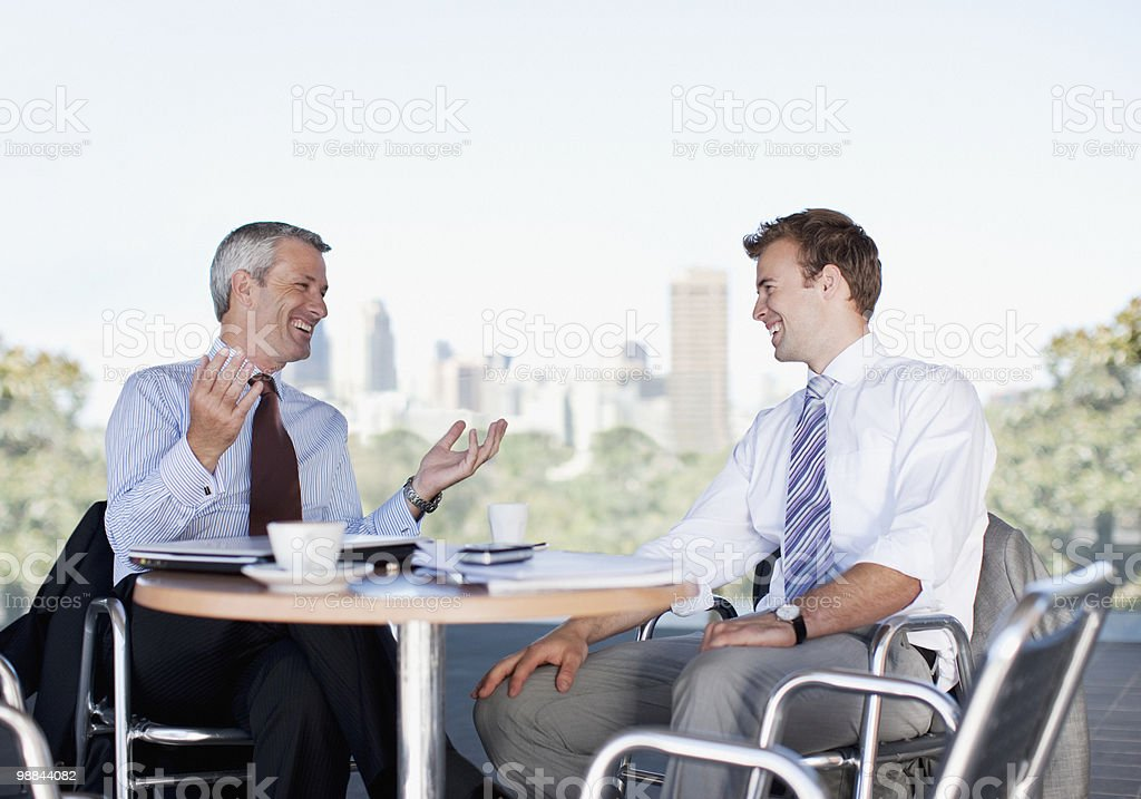 Businessmen talking in cafe royalty-free stock photo