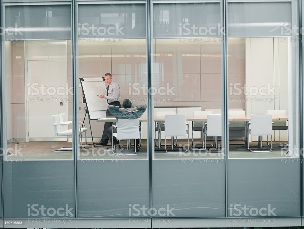 Businessmen talking in conference room royalty-free stock photo